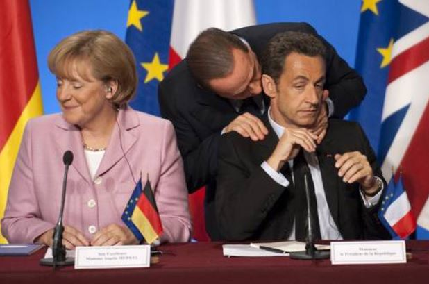 berlusconi kisses sarkozi and merkel laughs
